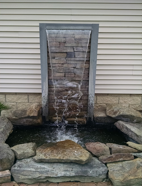 Diy pond waterfall spillway bing images for Pond waterfall spillway ideas